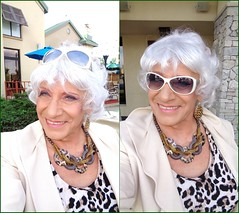 I Really Could Use Some Sunglasses Right About Now (Laurette Victoria) Tags: laurette woman milwaukee sunglasses silver pantsuit animalprint necklace