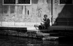 Artist at work [explored] (chaotic river) Tags: italy white black monochrome canal candid it venezia veneto silverefexpro2