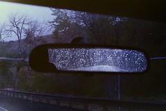 untitled (.:sean fitzgerald:.) Tags: dark film analog analogue rain water droplets rear view mirror emotion travel driving washington state minolta x700 wolverine scanner