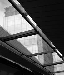 A glance upwards - London Quarter, London Bridge Station (surreyblonde) Tags: bw blackandwhite monochorme black grey canon g15 londonquarter london shard londonbridgestation buildings architecture londonskyline vortex wondow glass building