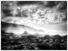 Emerging from the sea spray (Rob.J.Davis) Tags: seaspray coast coastline portreath cornwall rockpools clouds bw blackandwhite blackwhite ukcoast beach britain britishbeach