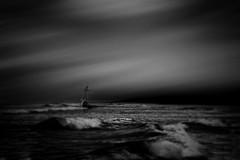 The Lost Vessel (Gianmario Masala) Tags: textures textured photoshop gimp blur blurry photomanipulation dark photograph gianmariomasala monochromatic shadows blackandwhite lowkey motion ship vessel sea ocean seascape waves