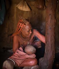 Body care Himba style (loveexploring) Tags: africa himba himbahairstyle himbawoman kaokoland kuneneregion namibia bodycare child deodorant hairplaits headdress incense indoors jewelry otjize skincare smoke tribalwoman tribe woman