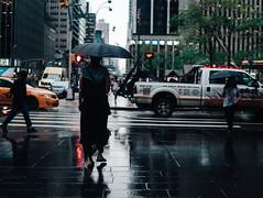 DSC08028 (Rickxcalde) Tags: rain umbrella nyc people newyorker streetphotography