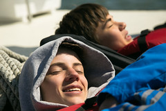 Quick nap (dannynavarrophoto) Tags: boy 2 sun man male face closeup happy virginia boat nap day ship unitedstates young peaceful rope teen maritime snooze teenager serene recreation relaxation adolescent