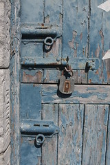 Bolted (Jolphin) Tags: door blue texture metal stone peeling paint timber board bolt weathered padlock stable distressed authentic textured
