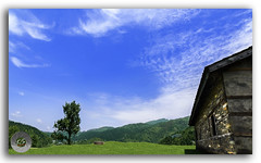 Idyllic and beautiful landscape with an old abandoned wooden house (FotographyKS!) Tags: wood old roof panorama india house mountain building tree brick green texture abandoned home nature grass rock horizontal wall architecture clouds forest trekking trek landscape outdoors town wooden nikon arch exterior empty ruin meadows bluesky nobody structure lodge haunted hills tropical serene aged nikkor mandi majestic uphill nikondigital mothernature himalayas himalayan himachalpradesh naturephotography natureabstract janjehli photoborder lushgreenery tokina1116mmf28 naturebackground 1116mmf28 natureadstract