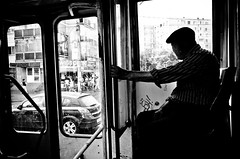 The Grit and Grime of a Former Communist City (stimpsonjake) Tags: nikoncoolpixa 185mm streetphotography bucharest romania city candid blackandwhite bw monochrome tram publictransport gritty oldman sitting silhouette