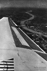 Winding Down the Mississippi (sethalanphoto) Tags: river city mississippi bw film blacknwhite plane wing