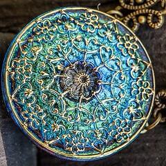 Gina closeup (lilyandquinn) Tags: glass colors necklace shiny colorful iridescent iridescence pendant celestial czechglass celestialcollection