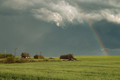Golden Days Of Summer (gerrypocha) Tags: rainbow storm prairie abandoned vista sky july