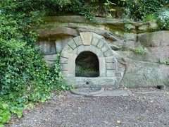 Jacob's Well, 2016 Jul 17 (Dunnock_D) Tags: uk unitedkingdom britain england chester path footpath trees grosvenorpark ruins arch jacobswell well rockface rock stone