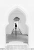walking on the corridor (abtabt) Tags: malaysia sarawak kuching holiday ramadan eidalfitr astana muslim hariraya festival fast aidilfitri man d7001835g corridor malay symmetry borneo islamic pedestrians