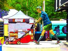 Caramel Nuts (Steve Taylor (Photography)) Tags: art digital sign sculpture streetart colourful vivid metal canvas man newzealand nz southisland canterbury christchurch cbd city trees avonsidedrive cap earprotectors hannahkidd mall mower petrol restart shorts steelrodcorrugatediron welds pergola caramel nuts glutenfree pricelist arrow tent