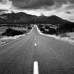 Camino Los Abuelos (Mabry Campbell) Tags: 2015 caminolosabuelos december h5d50c hasselblad mabrycampbell newmexico santafe santafecounty usa unitedstatesofamerica blackandwhite commercialphotography countryside fineartphotography highway image landscape monochrome mountains outdoors photo photograph photographer photography road roadscape squarecrop f12 december232015 20151223campbellb0000189 80mm sec 100 hc80