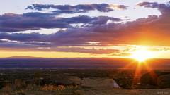 Sunset over Albuquerque (G.E.Condit) Tags: sunset sky newmexico southwest clouds landscape desert albuquerque sunburst nm mttaylor grantcondit