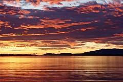 Sunset in Reykjavik (unnurol) Tags: sea sony ocean sunset sólarlag grafarvogur bryggjuhverfi yellow red blue sky clouds ský himininnlogar