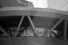 City Hall and reflections of Nathan Phillips Square (Richard Wintle) Tags: foma fomapan 200 adonal adox blackandwhite bw monochrome film 135 35mm 38mm f35 canon sureshot sureshotmax toronto ontario canada downtown cityhall nathanphillipssquare reflection reflections