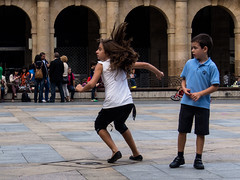 P9201343  Spain Basque Country Bilbao (Dave Curtis) Tags: 2013 em5 europe omd olympus spain basque country girl boy wild hair playing childern plaza mayor