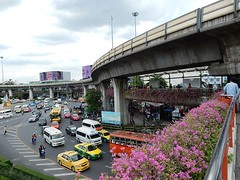 Skytrain Skirts Victory Monument Square (mikecogh) Tags: concrete traffic bangkok taxis bougainvillea minivans skytrain congestion minibuses victorymonument commutervans