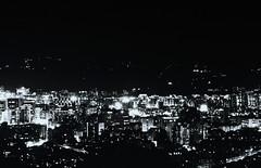 Taipei Noir - 03 (bluetrayne) Tags: city longexposure nightphotography urban building monochrome architecture skyscraper asia cityscape taiwan citylights taipei analogphotography  blackandwhitephotography