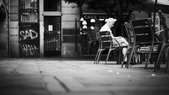 Reading quietly... (elgunto) Tags: barcelona street people reading chairs gotico blackwhite bw sonya7 nikon10525 manuallense
