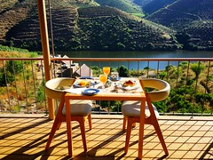 breakfast view (ekelly80) Tags: portugal june2016 summer vilanovadefozca guarda casadorio quintadovallado wine winecountry dourovalley douroriver beautiful scenery diningroom breakfast outside alfresco balcony view light morning sunlight table chairs water river valley mountains hills vineyards shadows brunch croissant orangejuice