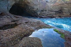 Hidden Cave and Reflections (Paul Hollins) Tags: seascape rocks australia newsouthwales cave aus winderosion catherinehillbay snapperpoint nikond7100