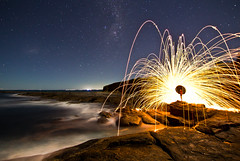 I went down down down... (PhilliB123) Tags: canon 600d t3i tokina 1116mm gerroa nsw south coast night photography steel wool spinning line milkyway stars ocean ring fire