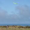 High! (brightasafig) Tags: jersey boy kite channelisland flying high wind sky joy child childhood running green dragon flutter air