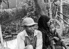 A family in a swamp area (yousufkurniawan) Tags: life family people blackandwhite woman monochrome rural kid streetphotography streetphoto farmer agriculture livelihood