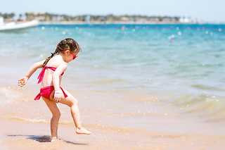Child splashing an the beach