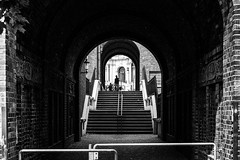 Steps and barriers / Every tunnel has two ends, some have a sunroof in the middle (zgr Grgey) Tags: 2016 50mm bw d750 darkcity hamburg nikon architecture shadow silhouettes steps street symmetry tunnel germany