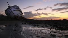 Stranded_ (J .H) Tags: boat beach sea sunset flickr sky landscapes explore stranded