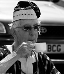 Village fete (3) (Neil. Moralee) Tags: old light portrait bw white man cup coffee monochrome strange smile face hat smiling shirt laughing happy mono glasses weird back nikon funny village natural tea outdoor robe candid bald neil moustache odd mature fete balding garb matute peoplr hemyock d7100 moralee neilmoralee july2016nikond7100