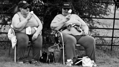 No Diet Today. (Neil. Moralee) Tags: devon village fete neil moralee nikon d7100 man matute old laughing funny bald balding shirt moustache happy smile smiling back white mono monochrome bw candid face portrait outdoor peoplr natural light blackdown hills rural event local people hat close mature glasses show agriculture agricultural tractor farmer crops cattle livestock prize charolaise cow bull cowman woman lady eating large ice cream two pair couple bbw black blackandwhite monochrom women sitting