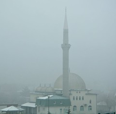 A foggy weather of a minaret in Kosovo
