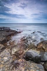 Pebbles in the surf (Tobias Schulte) Tags: steine felsen rocks pebbles brandung surf wellen long exposure langzeit belichtung sky himmel wolken clouds sea meer ozean wasser water waves myst nebel blau blue