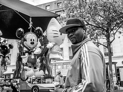 P1010731 (burnin moon) Tags: street blackandwhite man monochrome shop manchester toy mouse mono streetphotography disney mickey streettogs