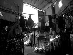 MARKETPLACE (marcobertarelli) Tags: market place shop contrast black white living human light shadows day souk little things material