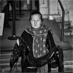 Portuguese saleswoman (John Riper) Tags: street bw woman white black portugal monochrome lady canon john square photography mono zwartwit lisboa lisbon candid l cape shawl plaid sales 6d 24105 straatfotografie riper johnriper belerm