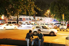 In the Comfort of Their Privacy (Mayank Austen Soofi) Tags: boy man wall friend place traffic delhi privacy connaught