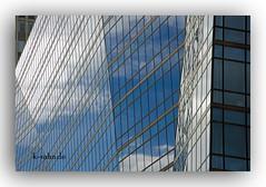 Glasfassade (K.Rahn) Tags: backgrounds klar konstruktion reflektor sunlight architektur aussen blau blickwinkel detail fassade fenster gebude gebudeteil gegensatz glas glaspalast glnzend haus hell himmel himmelblau kontrast modern moderne neu sonne spiegel spiegelung wolke wolken fotorahmen outdoor weiser hintergrund