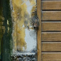 Quadretto N. 3 (sandroraffini) Tags: urban detail old town bologna tones matter decay wood abstract reality details rust metal legno intonaco muro wall toni ocra verde chiaro giallo impasto