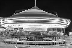 Spinnin' wheel got to go 'round (sniggie) Tags: kentuckystatefair louisville jeffersoncounty monochrome flyingsaucer amusementride merrygoround carousel