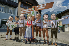 G7 leaders depicted with huge heads and kitted out with walking boots and maps have a choice of routes  the road towards fuelling inequality or fighting poverty. (Oxfam International) Tags: bayern deutschland protest demonstration bigheads deu oxfam garmischpartenkirchen g7 demonstranten