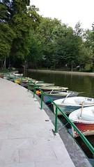 boats waiting (axelina2000) Tags: park summer green water boats pond bucharest cismigiu