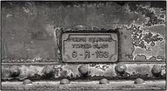Tender Plaque (NoJuan) Tags: blackwhite blackandwhite digitalbw olympusep5 olympus45mmf18 micro43 microfourthirds mft corrosion sign plaque