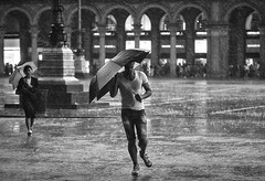 Wind Storm (Petricor Photography) Tags: street blackandwhite italy white black milan rain umbrella photography candid milano and raining canonpersonalconnection