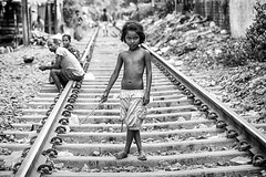 Tenerezza (daniele romagnoli - Tanks for 12 million views) Tags: road street portrait blackandwhite bw india monochrome face monocromo eyes nikon asia strada child indiana railway occhi sguardo indie sweetness kolkata ritratto indien bianconero calcutta dolcezza tenderness slum biancoenero slums inde ragazza ferrovia  indiani calcuta  tenerezza  d810   romagnolidaniele